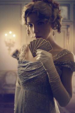 ILINA SIMEONOVA BLONDE REGENCY WOMAN HOLDING CARDS INDOORS