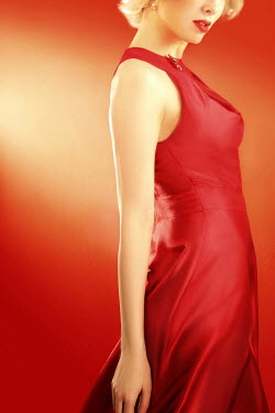 ILINA SIMEONOVA BLONDE WOMAN IN SLEEVELESS RED SILK DRESS