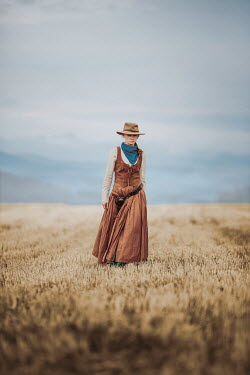 Magdalena Russocka historical woman in cowboy outfit standing in field