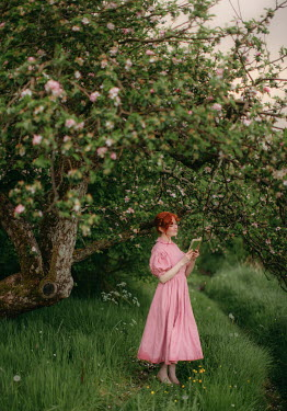 Rebecca Stice HAPPY WOMAN READING BY TREE IN BLOSSOM