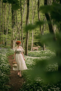 Rebecca Stice WOMAN WITH RED HAIR AND DOG ON FOREST PATH