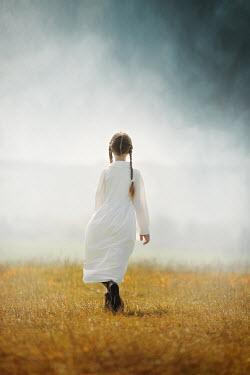 Anna Buczek HISTORICAL GIRL WITH PLAITS WALKING IN FIELD