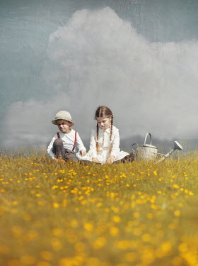 Anna Buczek LITTLE BOY AND GIRL SITTING IN FIELD WITH WATERING CAN