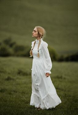 Anna Buczek BLONDE GIRL IN WHITE DAYDREAMING IN COUNTRYSIDE