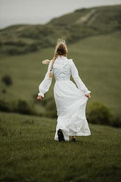 Anna Buczek BLONDE GIRL IN WHITE WALKING IN COUNTRYSIDE