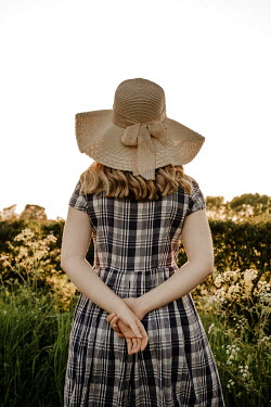 Esme Mai GIRL IN HAT AND PLAID DRESS OUTDOORS