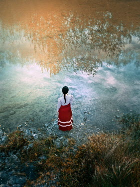 Mary Wethey WOMAN WATCHING REFLECTIONS OF TREES IN WATER