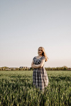 Esme Mai BLONDE GIRL WITH PLAID DRESS IN COUNTRYSIDE