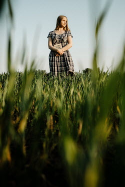 Esme Mai BLONDE GIRL WITH PLAID DRESS AND BOOK IN FIELD