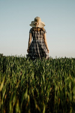 Esme Mai BLONDE GIRL WITH HAT AND PLAID DRESS IN FIELD