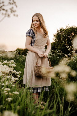 Esme Mai BLONDE WOMAN WITH BASKET IN SUMMER COUNTRYSIDE