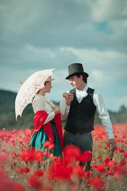 Ildiko Neer Historical couple standing in poppy field