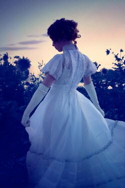 ILINA SIMEONOVA HISTORICAL WOMAN IN WHITE DRESS IN GARDEN AT DUSK