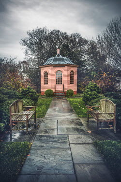 Evelina Kremsdorf FOLLY AND BENCHES BY WET GARDEN PATH
