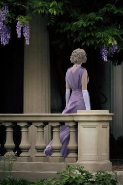 ILINA SIMEONOVA BLONDE 1930S  WOMAN OUTSIDE GRAND HOUSE