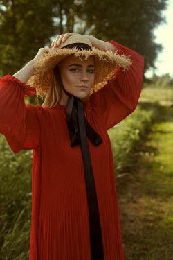Marina Chebanova BLONDE WOMAN WITH STRAW HAT IN COUNTRYSIDE