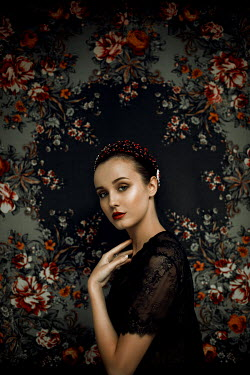 Marina Chebanova WOMAN IN LACE DRESS AND TIARA WITH FLORAL BACKGROUND