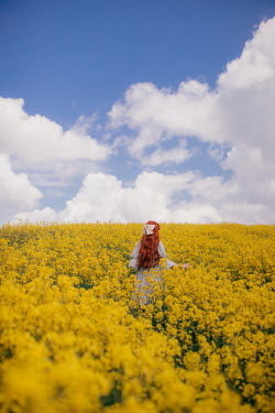 Rebecca Stice GIRL WITH RED HAIR IN MEADOW OF YELLOW FLOWERS