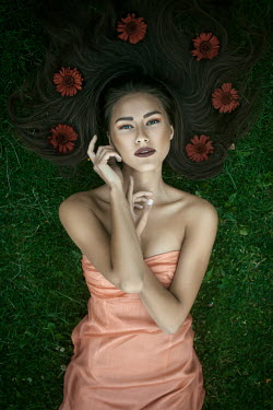Marina Chebanova WOMAN LYING ON GRASS WITH FLOWERS IN HAIR
