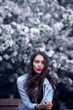 Marina Chebanova WOMAN IN DENIM JACKET BY TREE IN BLOSSOM