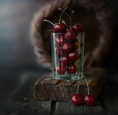 Andreeva Svoboda WET CHERRIES IN GLASS ON WOOD