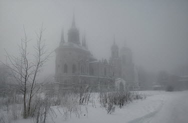 Andreeva Svoboda LARGE BUILDING WITH TOWERS IN FOG AND SNOW