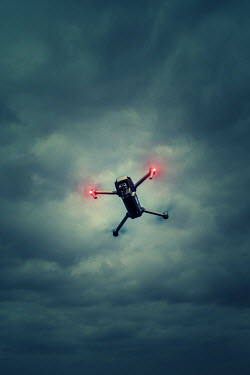 Magdalena Russocka drone hovering against cloudy sky