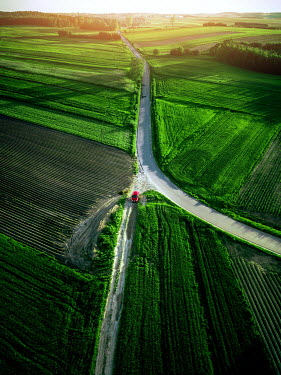 Magdalena Russocka red car on crossroads in fields from above