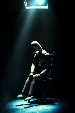 Magdalena Russocka posable wooden mannequin sitting on miniature chair in shadow with moonlight