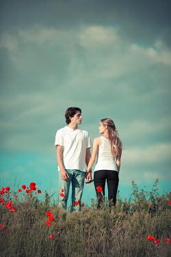 Ildiko Neer Young couple standing in field