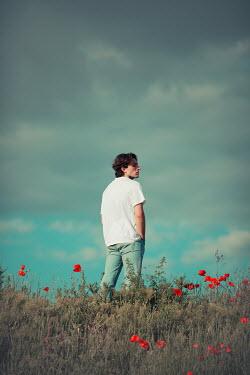 Ildiko Neer Young man standing in field