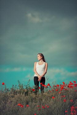 Ildiko Neer Young woman standing in field