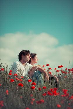 Ildiko Neer Young couple sitting in grass
