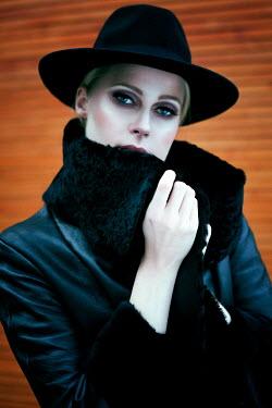 Marina Chebanova SERIOUS BLONDE WOMAN IN HAT OUTDOORS
