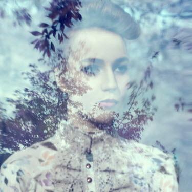Marina Chebanova WOMAN AT WINDOW WITH REFLECTION OF TREES
