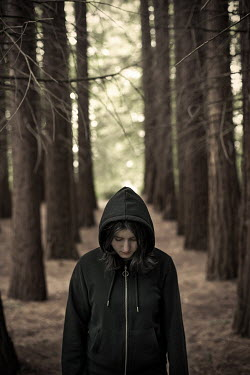 Svetlana Bekyarova SAD YOUNG GIRL IN HOOD STANDING IN FOREST