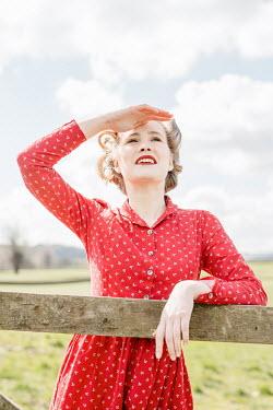 Shelley Richmond RETRO WOMAN BY GATE WATCHING SKY