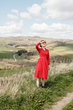 Shelley Richmond RETRO WOMAN IN COUNTRYSIDE WATCHING SKY