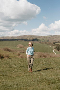 Shelley Richmond HAPPY RETRO WOMAN IN TROUSERS IN COUNTRYSIDE