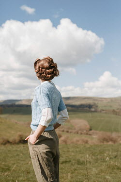 Shelley Richmond RETRO WOMAN IN TROUSERS STANDING IN COUNTRYSIDE