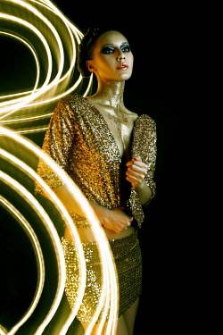 Marina Chebanova WOMAN COVERED WITH GLITTER IN SEQUINNED SKIRT AND JACKET