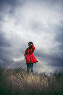 Marie Carr WOMAN IN RED COAT WATCHING ON DUNES
