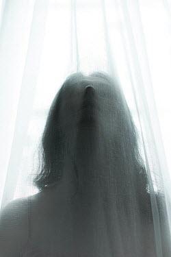 Ebru Sidar WOMAN WITH DARK HAIR BEHIND TRANSPARENT CURTAIN