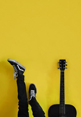 Lyn Randle MALE FEET LEANING ON WALL WITH GUITAR