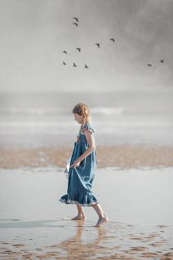 Anna Buczek BAREFOOT LITTLE GIRL WITH PLAITS ON BEACH