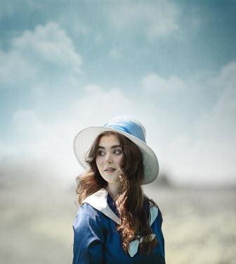 Anna Buczek BRUNETTE GIRL IN HAT OUTDOORS IN SUMMER
