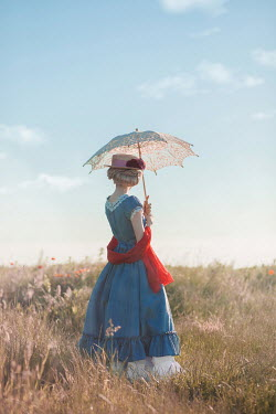 Ildiko Neer Historical woman standing in field with parasol