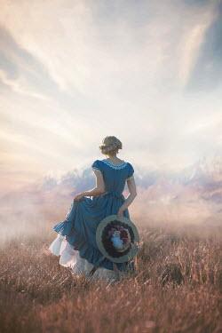 Ildiko Neer Historical woman walking in field by mountains