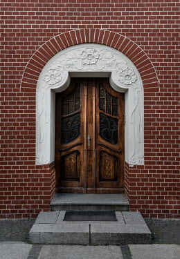 Jaroslaw Blaminsky RED BRICK BUILDING WITH DECORATIVE DOOR