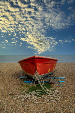 John Race SMALL RED BOAT WITH ROPES ON BEACH
